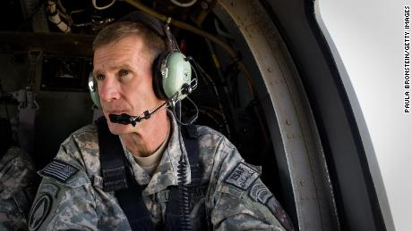Commander General Stanley McChrystal sits in the helicopter after a lengthy conference meeting with military officials in October 2009 at forward operating base Walton, outside of Kandahar, Afghanistan.