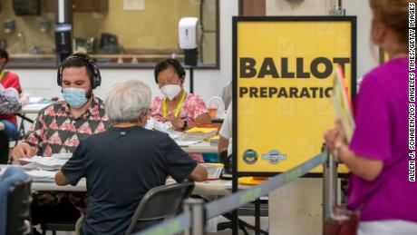 An observer who declined to give their name watches election workers process ballots (and signatures verified) at vote centers across the state during the California gubernatorial recall election, including the Orange County Registrar of Voters in Santa Ana, on Thursday, Sept. 9, 2021.