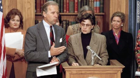 Former US senator, Barbara Boxer, second from right, and then senator Joseph Biden, at a press conference on Capitol Hill, discuss the violence against women act on February 24, 1993. (AP Photo/Barry Thumma)