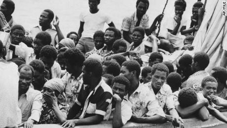Haitians arrive in Miami aboard a crowded sailboat in October 1979.