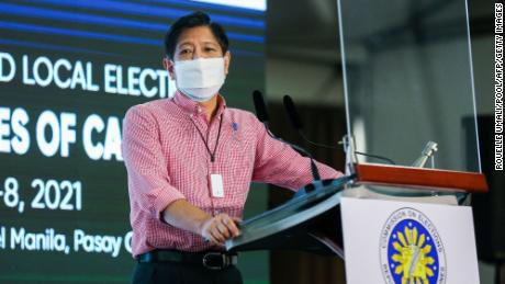 """Former Philippine senator Ferdinand """"Bongbong"""" Marcos Jr., son of former dictator Ferdinand Marcos, speaks after filing his candidacy in Pasay on October 6."""