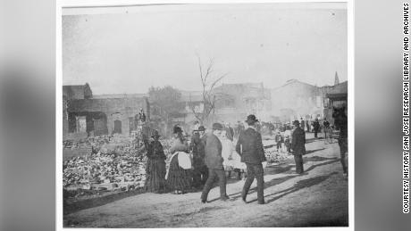 Residents of San Jose survey the destruction of the city's Chinatown in 1887.