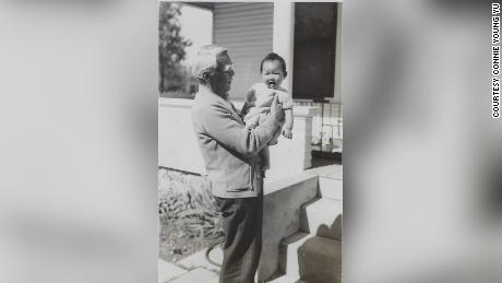 Young Wah Gok holds his granddaughter Connie Young Yu.