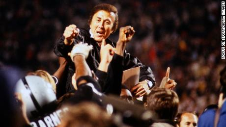 Head Coach Tom Flores of the Los Angeles Raiders is carried off the field by his players after they defeated the Washington Redskins 38-9 in Super Bowl XVIII  in 1984.